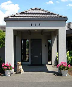 Front of Sprick Roofing office with dog Ruby